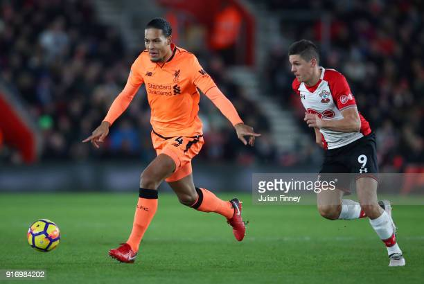 Virgil van Dijk of Liverpool battles for possesion with Guido Carrillo of Southampton during the Premier League match between Southampton and...