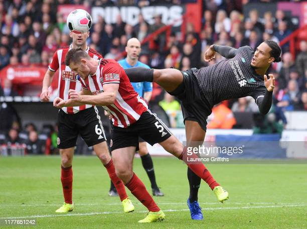 Virgil van Dijk of Liverpool battles for possession with Jack O'Connell of Sheffield United during the Premier League match between Sheffield United...
