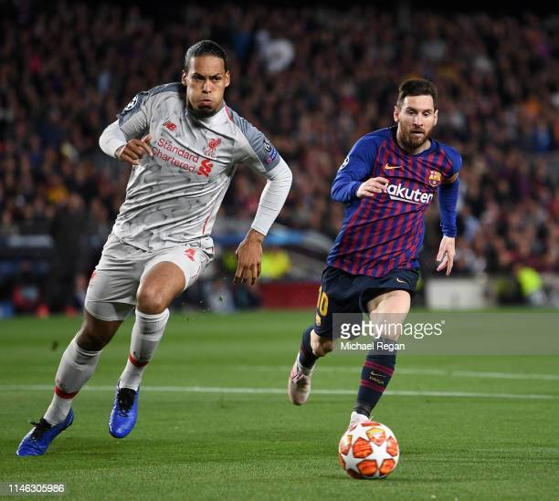 Virgil van Dijk of Liverpool battles for possession with Lionel Messi of Barcelona during the UEFA Champions League Semi Final first leg match...