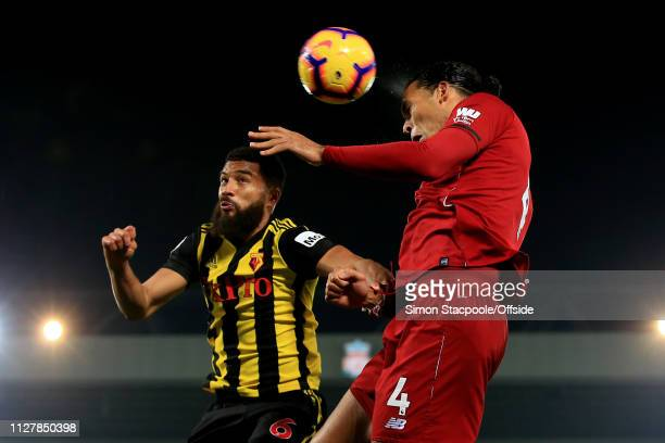 Virgil van Dijk of Liverpool battles with Adrian Mariappa of Watford during the Premier League match between Liverpool and Watford at Anfield on...