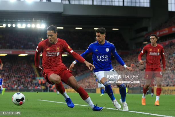 Virgil van Dijk of Liverpool battles with Ayoze Perez of Leicester during the Premier League match between Liverpool FC and Leicester City at Anfield...