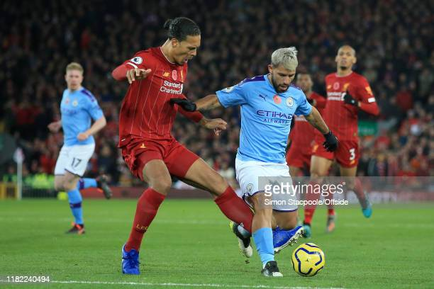 Virgil van Dijk of Liverpool battles with Sergio Aguero of Man City during the Premier League match between Liverpool FC and Manchester City at...