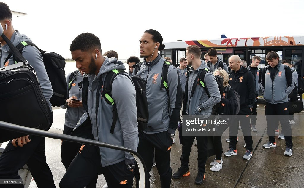 Virgil van Dijk of Liverpool board the plane for their trip to Porto at Liverpool John Lennon Airport on February 13, 2018 in Liverpool, England.