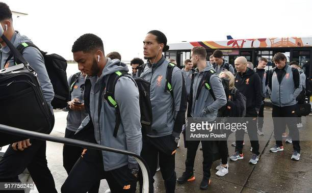 Virgil van Dijk of Liverpool board the plane for their trip to Porto at Liverpool John Lennon Airport on February 13 2018 in Liverpool England
