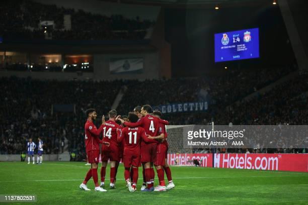 Virgil van Dijk of Liverpool celebrates after scoring a goal to make it 14 during the UEFA Champions League Quarter Final second leg match between...