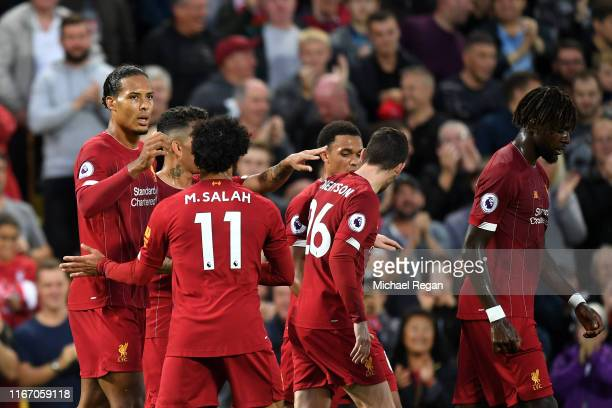 Virgil van Dijk of Liverpool celebrates after scoring his sides third goal during the Premier League match between Liverpool FC and Norwich City at...