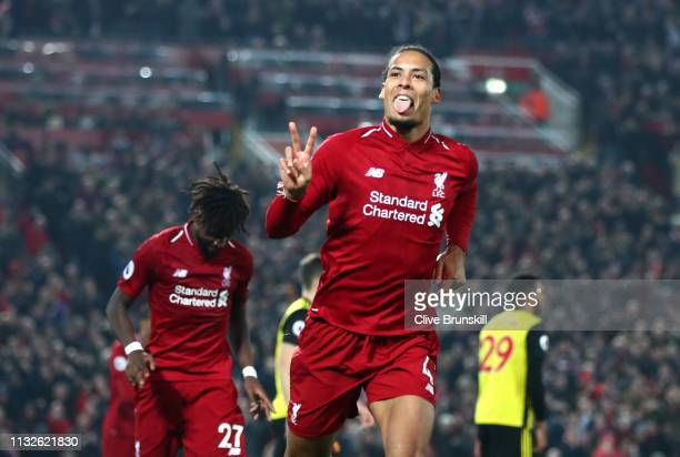 Virgil van Dijk of Liverpool celebrates after scoring his team's fifth goal during the Premier League match between Liverpool FC and Watford FC at...
