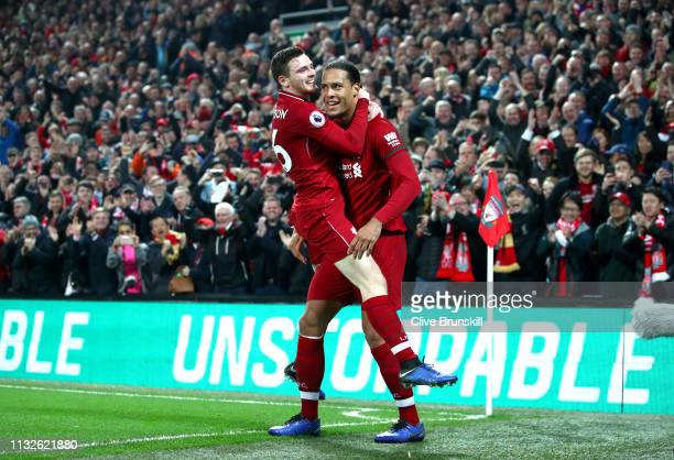 Virgil van Dijk of Liverpool celebrates after scoring his team's fifth goal with Andy Robertson of Liverpool during the Premier League match between...