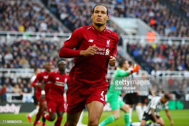 Virgil van Dijk of Liverpool celebrates after scoring his team's first goal during the Premier League match between Newcastle United and Liverpool FC...
