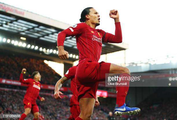 Virgil van Dijk of Liverpool celebrates after scoring his teams first goal during the Premier League match between Liverpool FC and Brighton Hove...