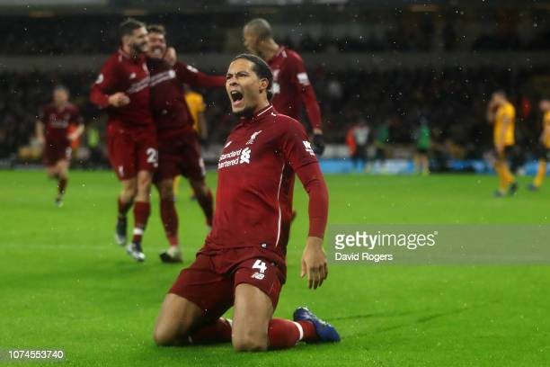 Virgil van Dijk of Liverpool celebrates after scoring his team's second goal of the game during the Premier League match between Wolverhampton...