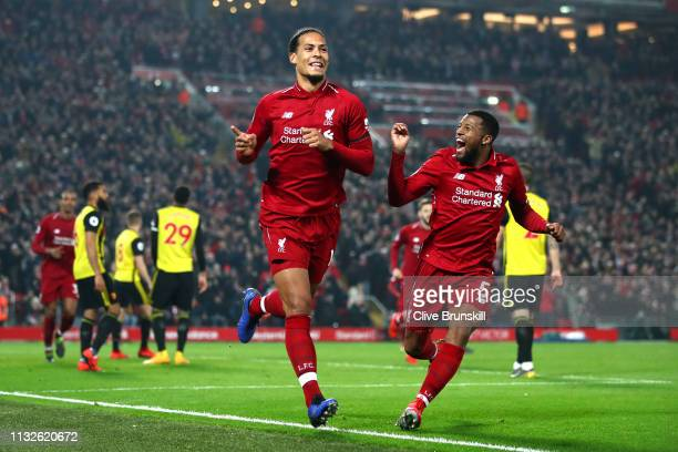 Virgil van Dijk of Liverpool celebrates after scoring his team's fourth goal with Georginio Wijnaldum of Liverpool during the Premier League match...