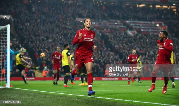 Virgil van Dijk of Liverpool celebrates after scoring his team's fourth goal during the Premier League match between Liverpool FC and Watford FC at...