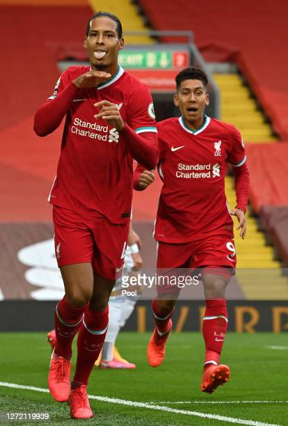 Virgil van Dijk of Liverpool celebrates after scoring his team's second goal during the Premier League match between Liverpool and Leeds United at...