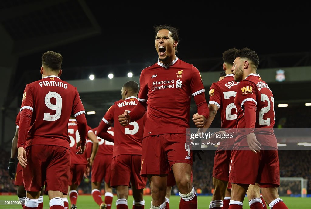 Virgil van Dijk of Liverpool celebrates after scoring the winning goal during The Emirates FA Cup Third Round match between Liverpool and Everton at Anfield on January 5, 2018 in Liverpool, England.