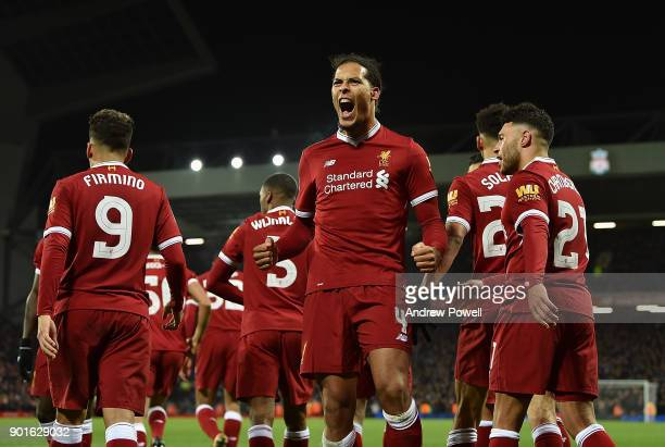 Virgil van Dijk of Liverpool celebrates after scoring the winning goal during The Emirates FA Cup Third Round match between Liverpool and Everton at...