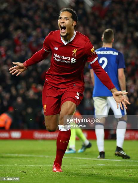 Virgil van Dijk of Liverpool celebrates after scoring the winning goal during the Premier League match between Everton and Manchester United at...