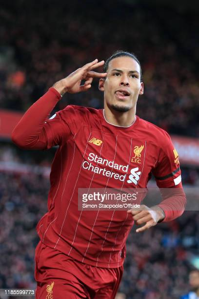 Virgil van Dijk of Liverpool celebrates after scoring their 1st goal during the Premier League match between Liverpool FC and Brighton Hove Albion at...