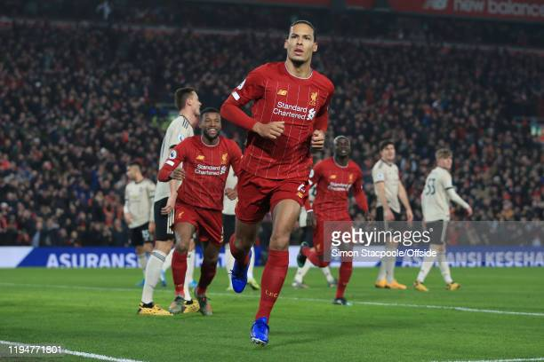 Virgil van Dijk of Liverpool celebrates after scoring their 1st goal during the Premier League match between Liverpool FC and Manchester United at...