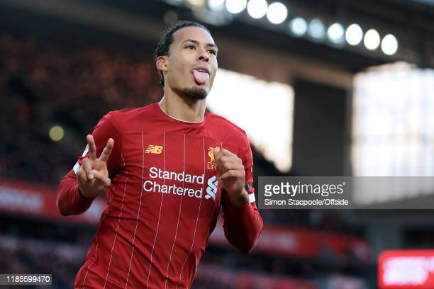 Virgil van Dijk of Liverpool celebrates after scoring their 2nd goal during the Premier League match between Liverpool FC and Brighton Hove Albion at...