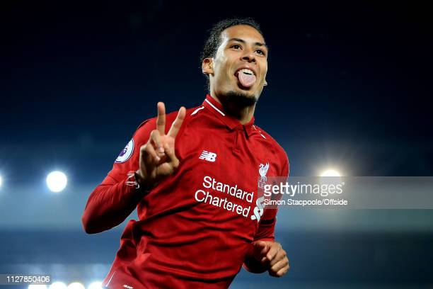 Virgil van Dijk of Liverpool celebrates after scoring their 5th goal during the Premier League match between Liverpool and Watford at Anfield on...