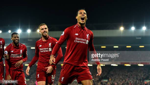 Virgil Van Dijk of Liverpool celebrates after socing the forth goal during the Premier League match between Liverpool FC and Watford FC at Anfield on...