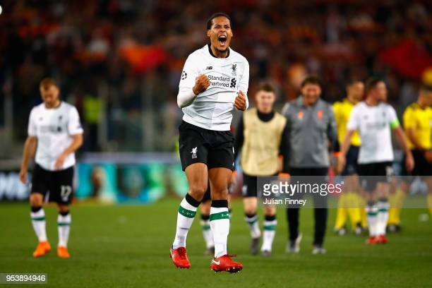 Virgil van Dijk of Liverpool celebrates after the full time whistle as Liverpool qualify for the Champions League Final during the UEFA Champions...