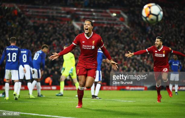 Virgil van Dijk of Liverpool celebrates as he scores their second goal during the Emirates FA Cup Third Round match between Liverpool and Everton at...