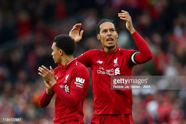 Virgil van Dijk of Liverpool celebrates at full time during the Premier League match between Liverpool FC and Tottenham Hotspur at Anfield on March...