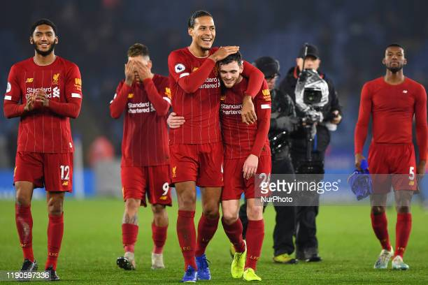 Virgil van Dijk of Liverpool celebrates by patting Andrew Robertson of Liverpool on the head during the Premier League match between Leicester City...