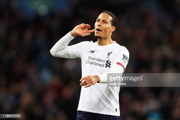 Virgil van Dijk of Liverpool celebrates following his sides victory in the Premier League match between Aston Villa and Liverpool FC at Villa Park on...