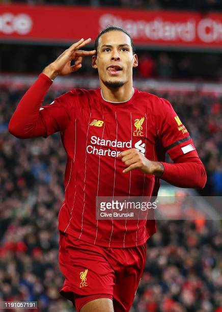 Virgil van Dijk of Liverpool celebrates goal during the Premier League match between Liverpool FC and Brighton Hove Albion at Anfield on November 30...