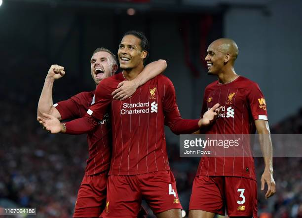 Virgil Van Dijk of Liverpool celebrates his first goal during the Premier League match between Liverpool FC and Norwich City at Anfield on August 09...