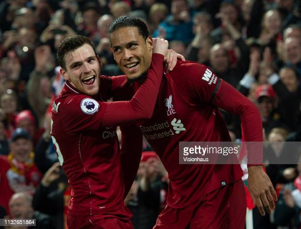 Virgil van Dijk of Liverpool celebrates scoring his second goal with team mate Andrew Robertson during the Premier League match between Liverpool FC...