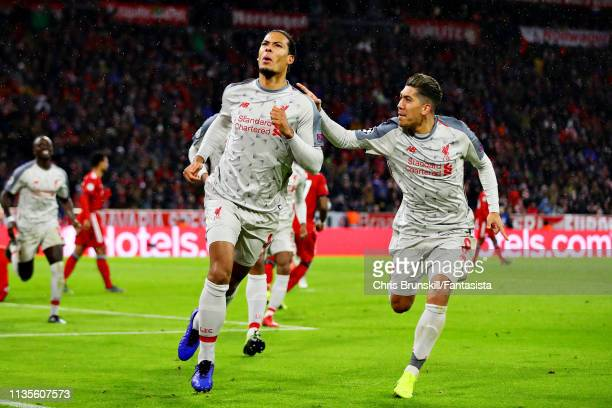 Virgil van Dijk of Liverpool celebrates scoring his sides second goal with teammate Roberto Firmino during the UEFA Champions League Round of 16...