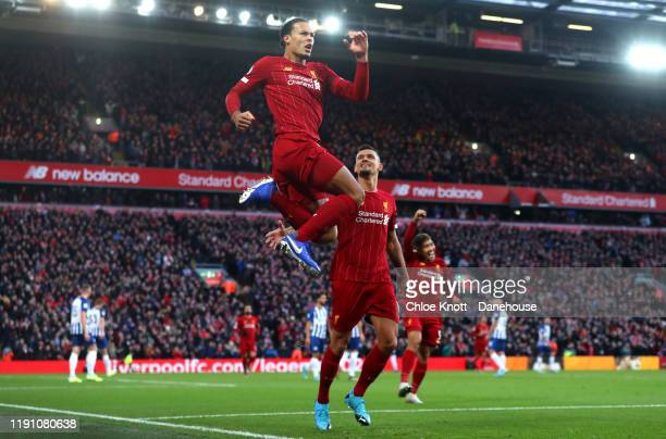 Virgil Van Dijk of Liverpool celebrates scoring his teams first goal during the Premier League match between Liverpool FC and Brighton Hove Albion at...