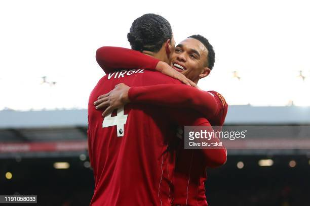 Virgil van Dijk of Liverpool celebrates scoring his teams second goal with team mate Trent AlexanderArnold during the Premier League match between...