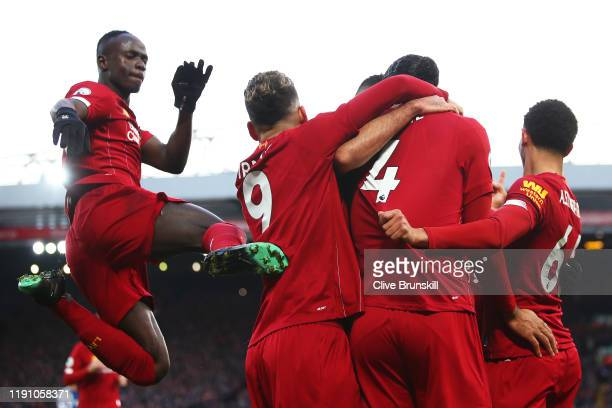 Virgil van Dijk of Liverpool celebrates scoring his teams second goal with team mates during the Premier League match between Liverpool FC and...