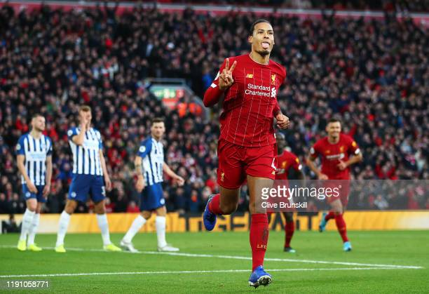Virgil van Dijk of Liverpool celebrates scoring his teams second goal during the Premier League match between Liverpool FC and Brighton Hove Albion...