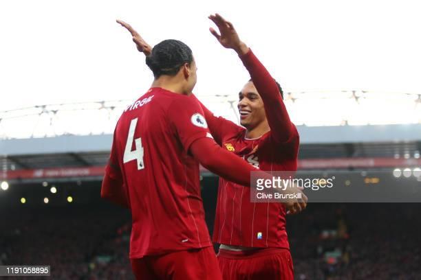 Virgil van Dijk of Liverpool celebrates scoring his teams second goal with team mate Trent AlexanderArnold during the Premier League match between...