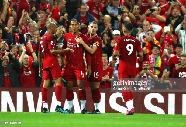 Virgil Van Dijk of Liverpool celebrates scoring his teams third goal during the Premier League match between Liverpool FC and Norwich City at Anfield...