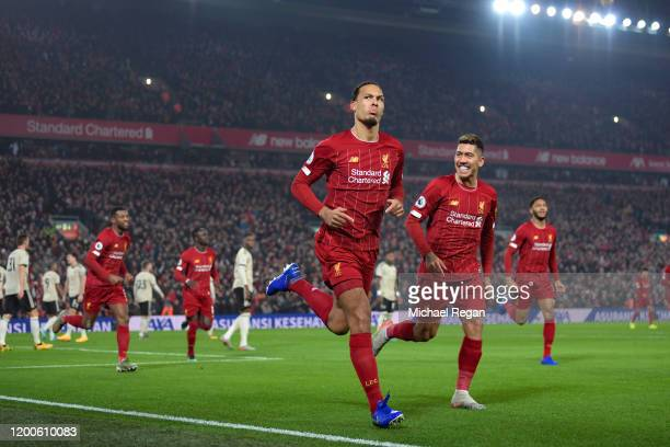 Virgil van Dijk of Liverpool celebrates scoring to make it 1-0 during the Premier League match between Liverpool FC and Manchester United at Anfield...