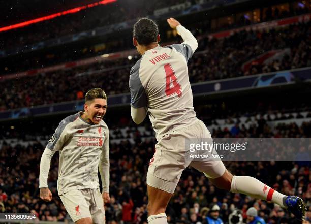 Virgil Van Dijk of Liverpool celebrates the sercond goal during the UEFA Champions League Round of 16 Second Leg match between FC Bayern Muenchen and...