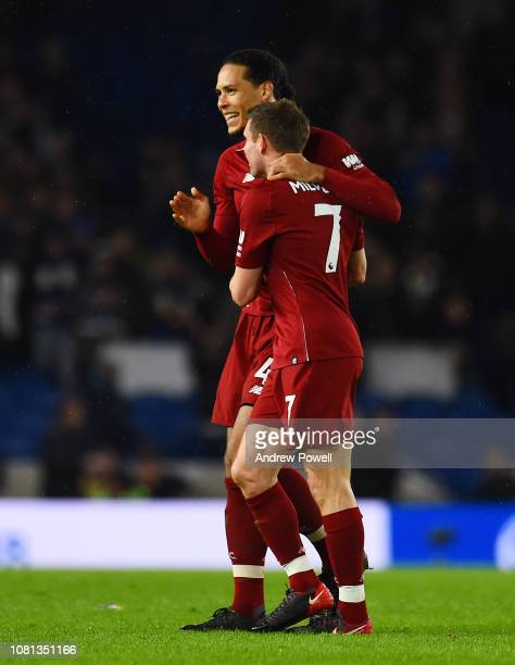 Virgil van Dijk of Liverpool celebrates the victory with James Milner at the end of the Premier League match between Brighton Hove Albion and...