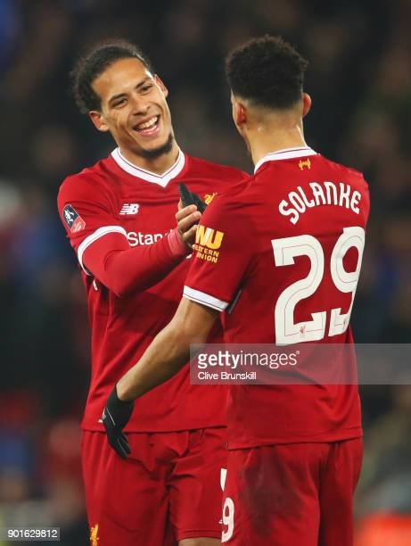 Virgil van Dijk of Liverpool celebrates victory with Dominic Solanke after the Emirates FA Cup Third Round match between Liverpool and Everton at...