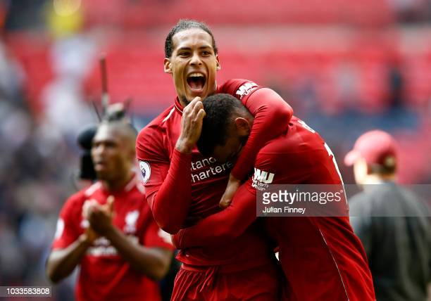 Virgil van Dijk of Liverpool celebrates victory with Georginio Wijnaldum of Liverpool after the Premier League match between Tottenham Hotspur and...