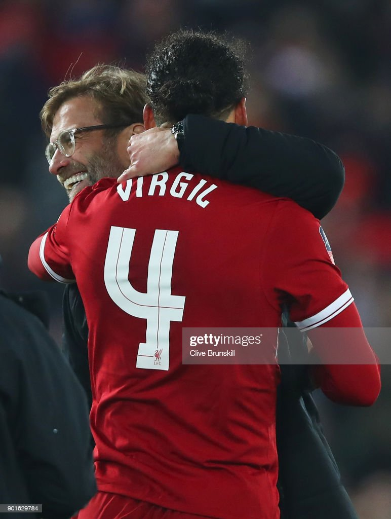 Virgil van Dijk of Liverpool celebrates victory with Jurgen Klopp, Manager of Liverpool after the Emirates FA Cup Third Round match between Liverpool and Everton at Anfield on January 5, 2018 in Liverpool, England.