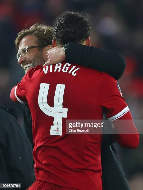 Virgil van Dijk of Liverpool celebrates victory with Jurgen Klopp Manager of Liverpool after the Emirates FA Cup Third Round match between Liverpool...