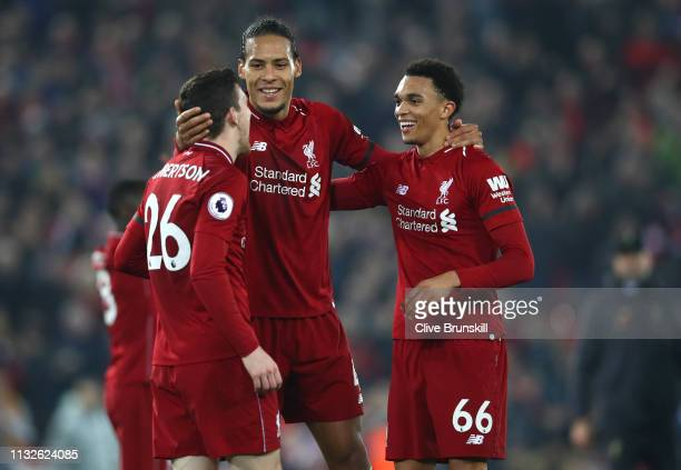 Virgil van Dijk of Liverpool celebrates victory with Trent AlexanderArnold of Liverpool and Andy Robertson of Liverpool after the Premier League...