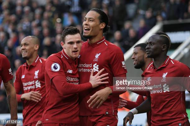 Virgil van Dijk of Liverpool celebrates with Andrew Robertson of Liverpool after scoring their 1st goal during the Premier League match between...